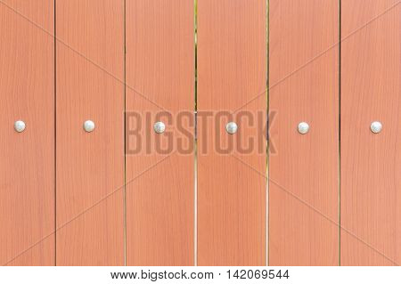 Wooden fence texture background.Close up of the pattern of plank on wooden fence with the steel rivet.