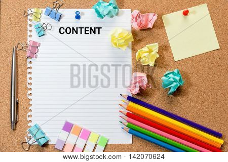Cork board with content wording on paper colorful blank notes color pencil tag trash and push pins.