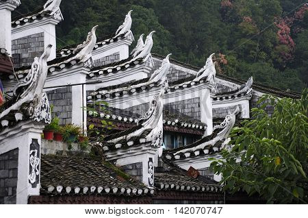 Chinese architecture and the roof on buildings within Fenghuang Village in Hunan province China.