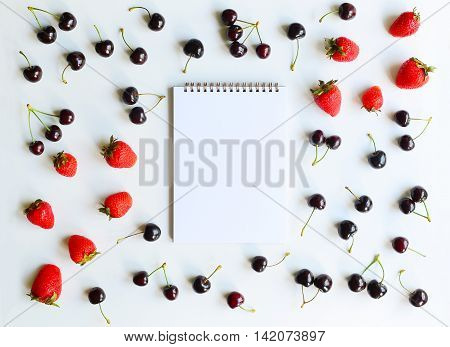Album cherry and strawberry on white background. Flat lay. Mock up for art work
