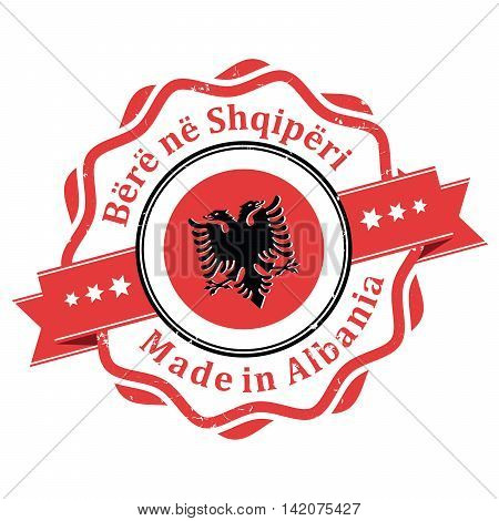 Made in Albania (text translation of Albanian characters) - stamp with the flag of Albania. Print colors used