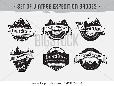 Set of mountain adventure and travel emblems. Exploration vector badges.