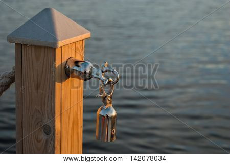 Carbine-lock chromed steel mounted on the column the background of the water surface.