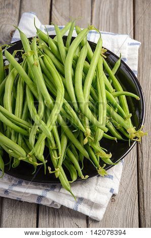 French beans on wooden background, selective focus