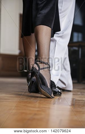 Low Section Of Tango Dancers Performing In Restaurant