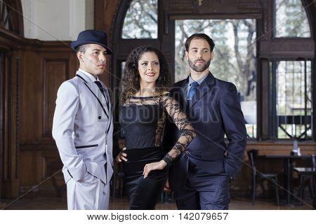 Welldressed Tango Dancers Looking Away In Restaurant