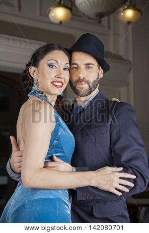 Confident Tango Dancers Embracing In Restaurant