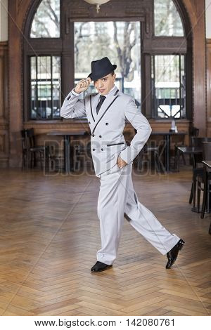 Confident Dancer With Hand In Pocket Performing Tango