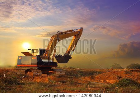 Excavator working and moving earth in construction afternoon