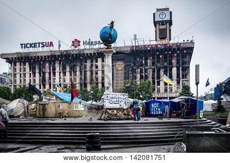 Burned-out building, memorial board and tents. Burned-out building Kiev, Ukraine  Maidan Nezalezhnosti, Kiev, Ukraine - May 15, 2014: a burned-out building, outskirts of Maidan Nezalezhnosti.
