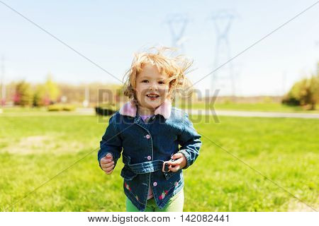 Pretty Little Girl Playing Outdoors In Spring