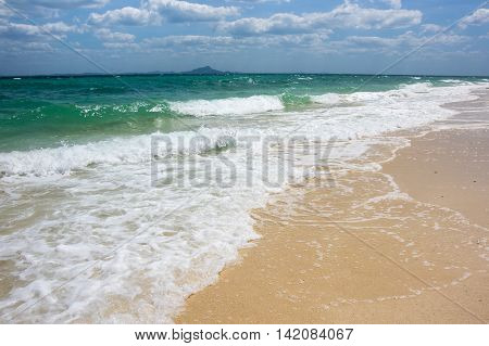 Waves running on the beach of Andaman sea Krabi province Thailand