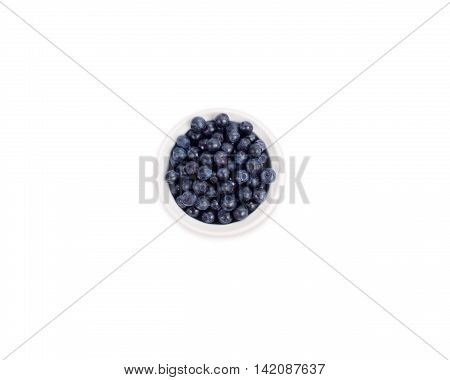 Bilberries in a white ceramic bowl. Berry isolated on white background.