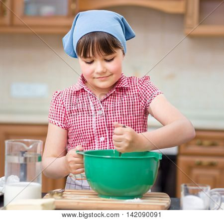 Girl is cooking, mixing something bowl, indoor shoot