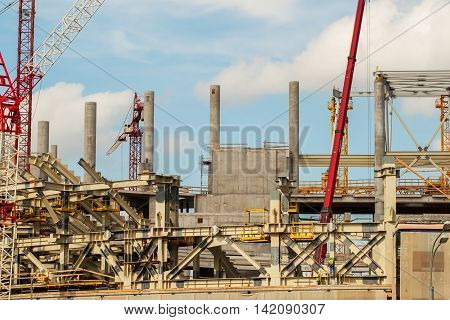 Construction concept , industry , work and structure at the building site against the background of blue sky
