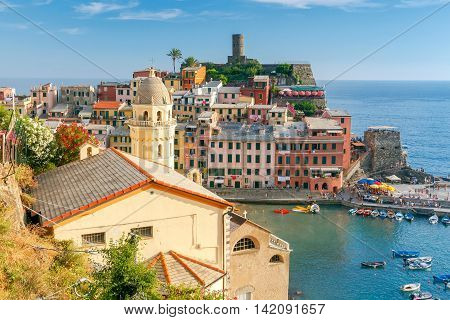 View from the hill of the village of Vernazza and the old harbor on a sunny day. Cinque Terre National Park. Liguria. Italy.