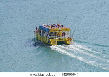 Mahon/Spain. 21st June 2012. Tourists enjoy a boat cruise in Mahon harbour on a warm June summer afternoon.