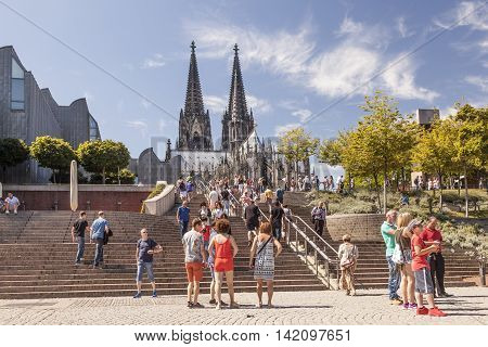 COLOGNE GERMANY - AUG 7 2016: People in front of the Cologne Cathedral. North Rhine-Westphalia Germany
