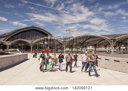 COLOGNE GERMANY - AUG 7 2016: People in front of the Main Train Station in the city of Cologne. North Rhine-Westphalia Germany