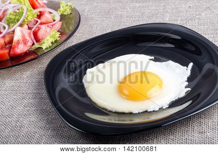 Useful Homemade Breakfast Of Fried Egg And A Salad