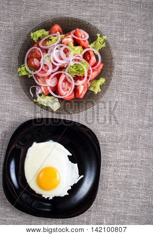 Top View Of A Healthy Homemade Breakfast Of Fried Eggs And A Salad