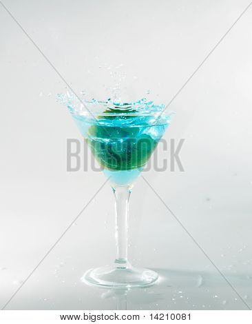 splashing on blue martini on white