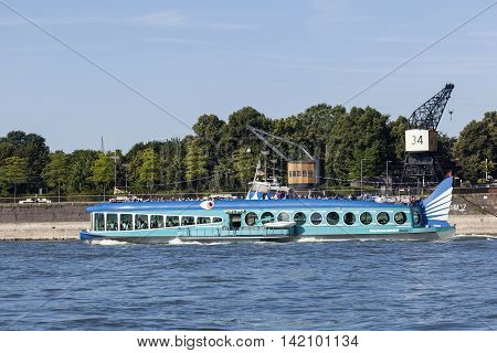 COLOGNE GERMANY - AUG 7 2016: Blue cruise ship Moby Dick on the Rhine river in Cologne Germany