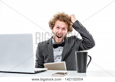 Businessman at the workplace working, depression and crisis concept