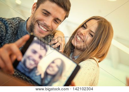 Couple taking a selfie.They are enjoying together and having a great time.