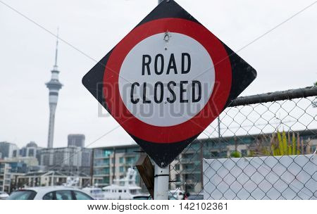 Road closed sign with apartments in the background in Auckland CBD New Zealand NZ
