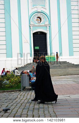 SERGIEV POSAD, RUSSIA - SEPTEMBER 06, 2012: Priests in Trinity Sergius Lavra Sergiev Posad Russia. UNESCO World Heritage Site.