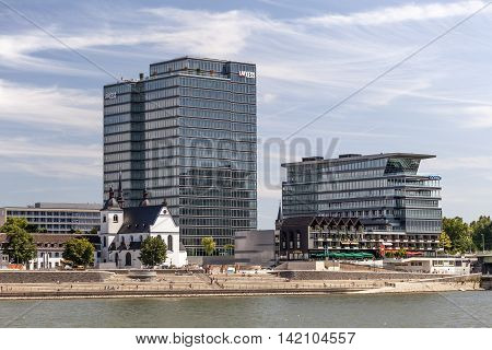 COLOGNE GERMANY - AUG 7 2016: Modern office buildings and the Rheinboulevard at the Rhine river bank in Cologne Germany