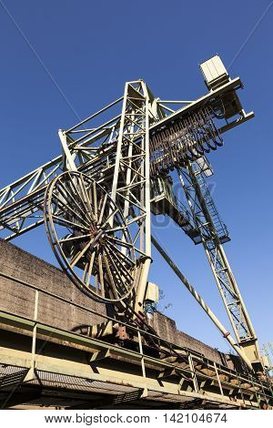 An old harbor crane in Cologne Germany