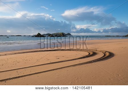 Tyre tracks in the sand on the beach at Tauranga Bay Far North Northland New Zealand NZ