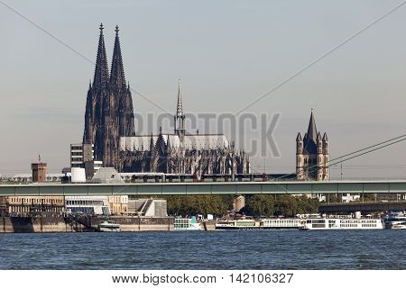The Cologne Cathedral and St. Martins Church in the city of Cologne North Rhine-Westphalia Germany