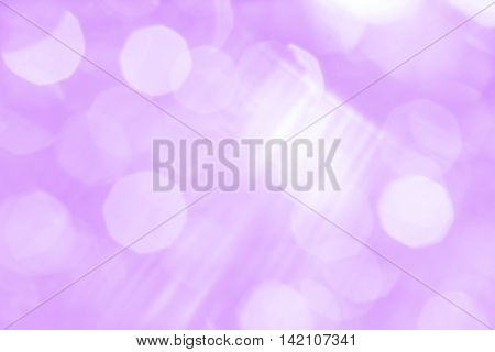 Abstract lilac background with white rays and sun glare