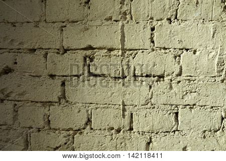 Plot brick walls, shaded with yellow paint, uneven lighting.