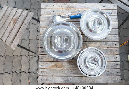 Stainless steel pot kitchenware on wood table