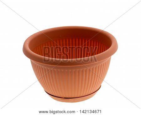 Empty garden plastic pot on a white background