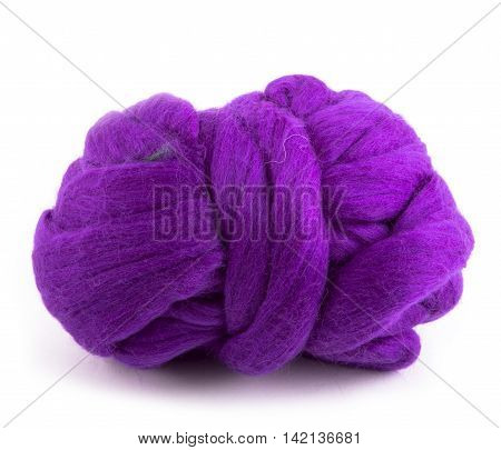 Skein of merino wool purple color on a white background