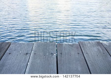 Close up wooden pathway for sitting along riverside