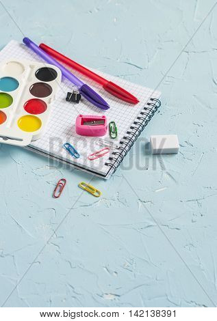 School supplies on blue background. Free space for text