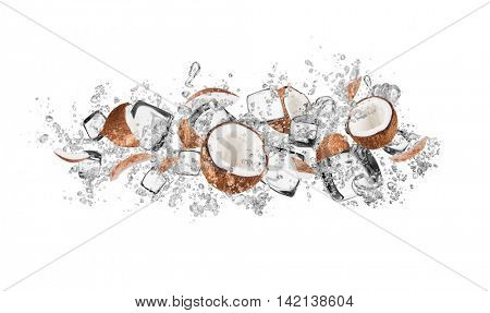 Pieces of coconuts in water splash and ice cubes, isolated on white background