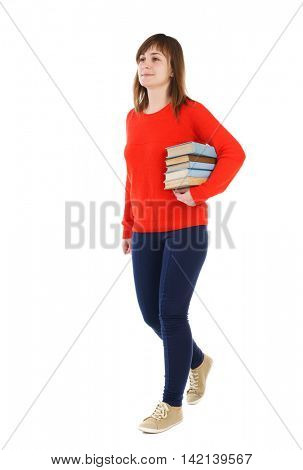 Girl comes with  stack of books. side view. Rear view people collection.  backside view of person.  Isolated over white background. smiling girl in a turquoise jacket carries a stack of books in the