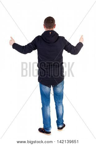 Back view of  man in jacket shows thumbs up.   Rear view people collection.  backside view of person.  Isolated over white background. A guy in a black jacket showing thumbs up with both hands.