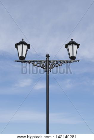 lanterns decorated with cast iron against the blue sky