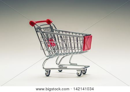Shopping trolley. Shopping cart. Shopping trolley on multi collored background. Free space for your informations.