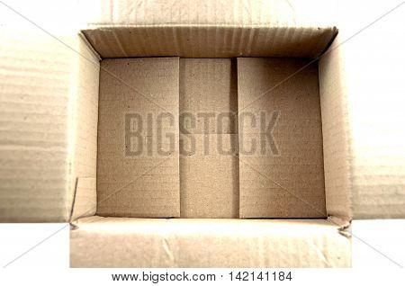 Top view of carton box on white