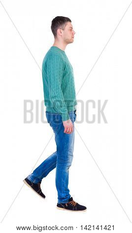Back view of going  handsome man. walking young guy . Rear view people collection.  backside view of person.  Isolated over white background. A man in a green jacket and jeans thoughtfully out of the