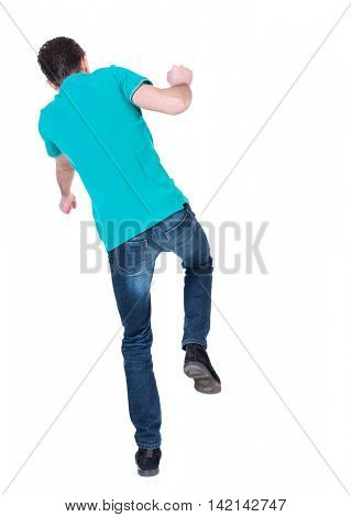 Balancing young man.  or dodge the falling man. Rear view people collection.  backside view of person.  Isolated over white background. Curly man in a turquoise jacket falls to the side.